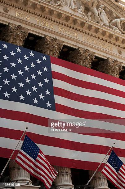 US flags are viewed outside the New York Stock Exchange August 3 2011 in New York World stock markets extended losses Wednesday as relief over a US...