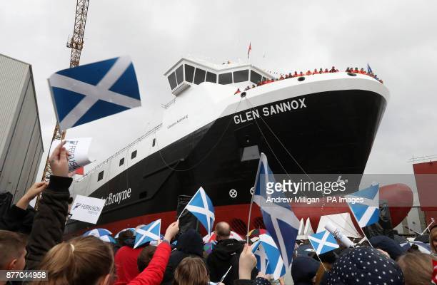 Flags are waved at a launch ceremony for the liquefied natural gas passenger ferry MV Glen Sannox the UK's first LNG ferry at Ferguson Marine...