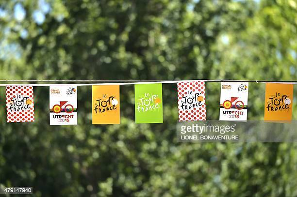 Flags bearing the Tour de France logo and colors of jerseys are pictured in a street of Utrecht The Netherlands on July 1 three days before the start...