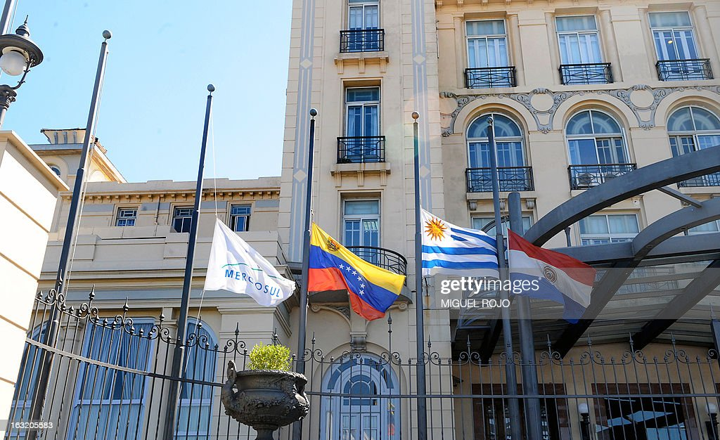 Flags flutter at half-mast at the Mercosur headquarters in Montevideo, on March 6, 2013, in mourning for the death of Venezuelan President Hugo Chavez on the eve. Condolences poured in Wednesday from world leaders who had found common cause with Venezuela's Hugo Chavez in his 14-year campaign to galvanize the Latin American left and defy US 'imperialism.' AFP PHOTO/Miguel ROJO