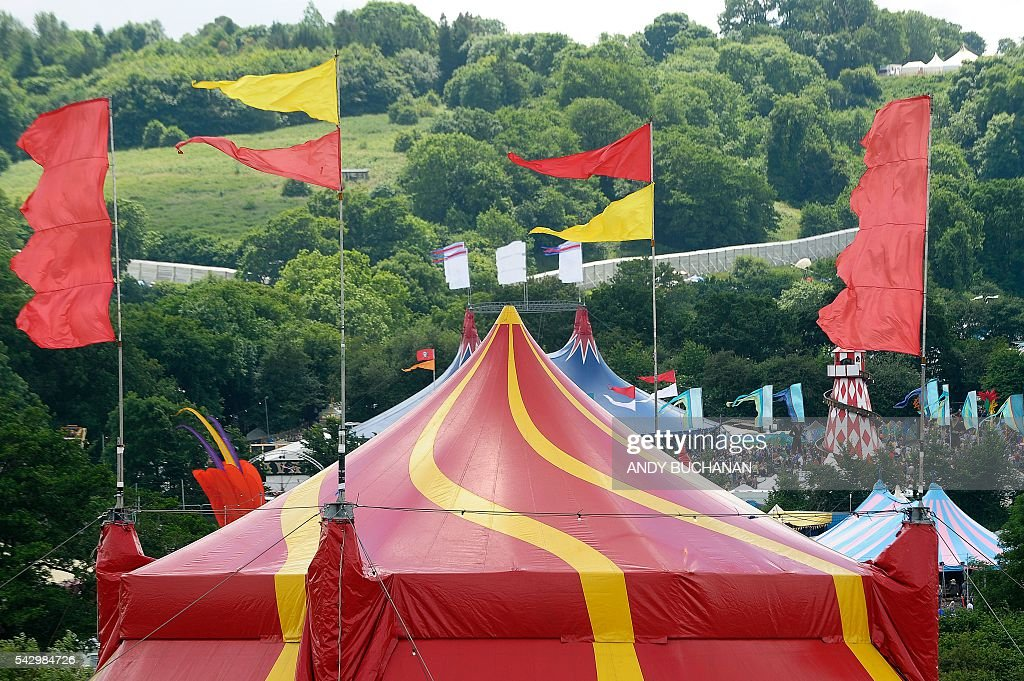 Flags flutter in the breeze on day four of the Glastonbury Festival of Music and Performing Arts on Worthy Farm near the village of Pilton in Somerset, South West England on June 25, 2016. / AFP / Andy Buchanan