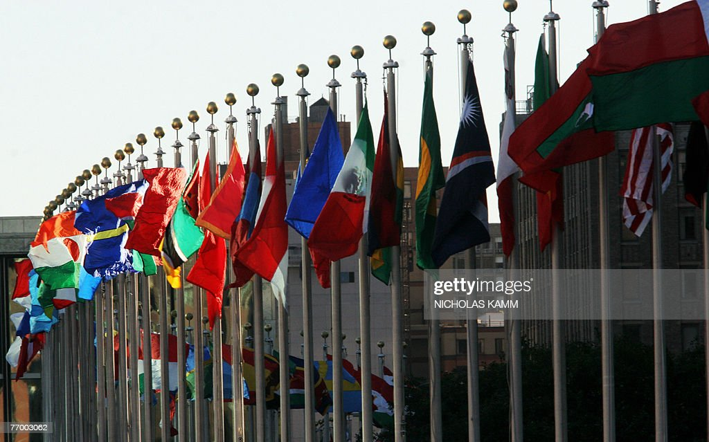 Flags flutter in the wind outside United Nations headquarters in New York 24 September 2007 on the eve of the UN General Assembly AFP PHOTO/Nicholas...