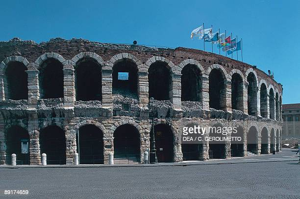 Flags fluttering on the top of an arena Verona Veneto Italy
