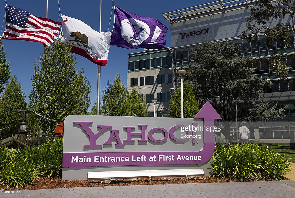 Flags fly above Yahoo! Inc. signage displayed at the company's headquarters in Sunnyvale, California, U.S., on Tuesday, April 16, 2013. Yahoo! Inc., the biggest U.S. Web portal, forecast sales that fell short of analysts' estimates as it continued to lose advertisers to Google Inc. and Facebook Inc. Photographer: David Paul Morris/Bloomberg via Getty Images