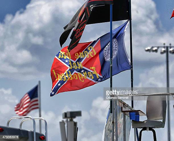 Flags fly at Daytona International Speedway including a variation of a confederate/Georgia state flag ahead of the Coke Zero 400 at Daytona...