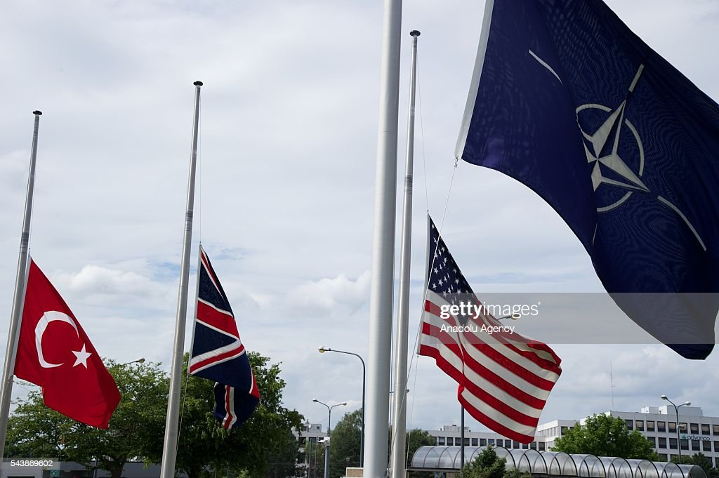 Flags fly at half mast in front of the NATO headquarters in Brussels, Belgium following the Istanbul terror attack on June 30, 2016.