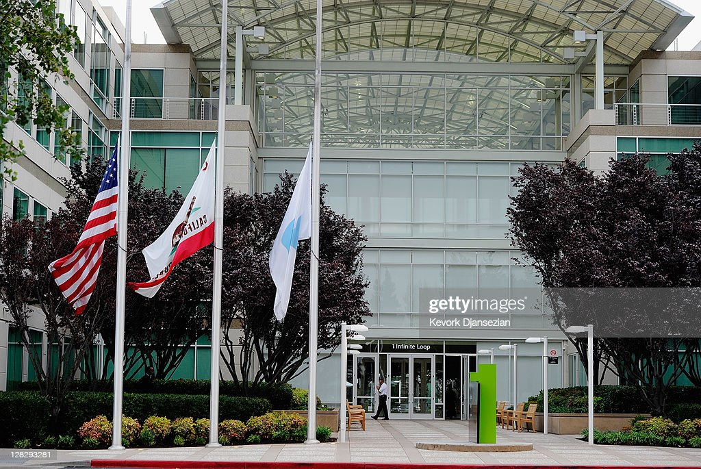 Flags fly at half staff following the death of Steve Jobs at the Apple headquarters on October 5 2011 in Cupertino California Jobs died October 5...