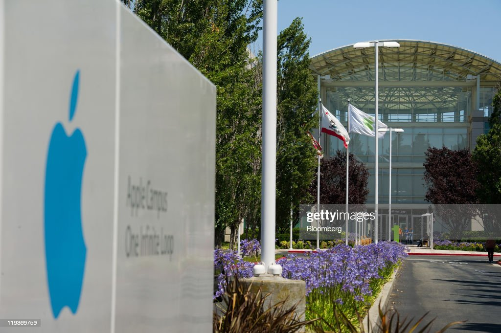 Flags fly at the entrance to Apple Inc headquarters in Cupertino California US on Friday July 15 2011 Apple Inc is set to post a 69 percent jump in...