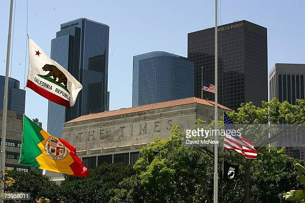 Flags fly halfstaff near the Los Angeles Times building April 23 2007 in Los Angeles California The Times announced today that it will offer...