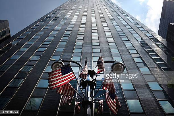 Flags fly in front of New York Governor Andrew Cuomo's office building as activists community leaders and family members who have lost loved ones in...