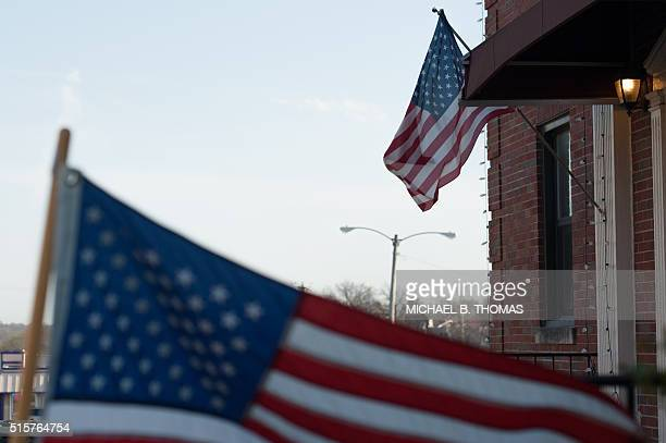 US flags fly outside a polling station during Missouri primary voting at the First Baptist Church of Ferguson on March 15 2016 in Ferguson Missouri...