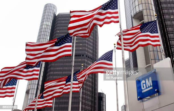 Flags fly outside the General Motors world headquarters building May 27 2009 in Detroit Michigan GM announced today that it failed trying to trade...
