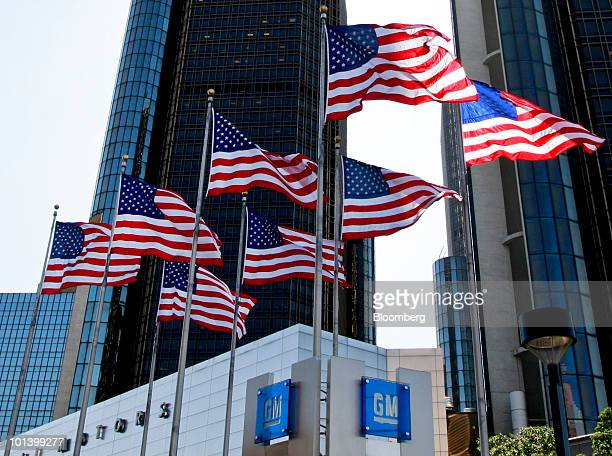US flags fly outside the headquarters building of General Motors Co in Detroit Michigan US on Tuesday June 1 2010 General Motors Corp filed for...