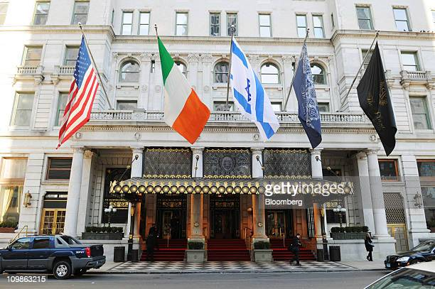 Flags fly outside The Plaza Hotel during the Bank of America Corp investor conference in New York US on Tuesday March 8 2011 Bank of America the...