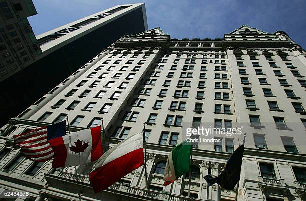 Flags fly outside the Plaza Hotel March 16 2005 in New York City The legendary Plaza Hotel which opened in 1907 and hosted New York's elite for...