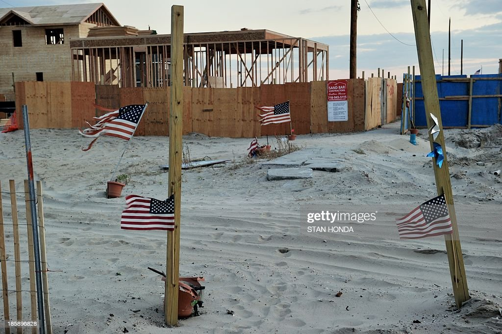 Flags fly where houses once stood in the Breezy Point section of the Queens borough of New York on October 24 2013 as some homeowners rebuild one...