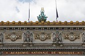 Flags flying at halfmast are tied with black ribbons above the Palais Garnier opera house in Paris on July 15 in honour of the victims of the attack...