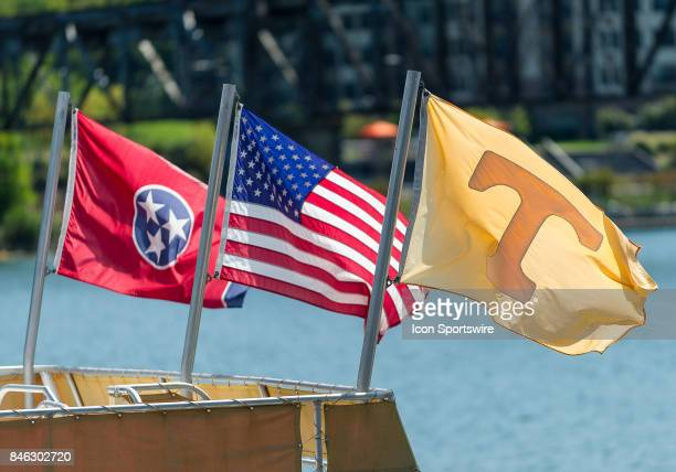Flags flying on a Vol Navy boat before a game between the Indiana State Sycamores and Tennessee Volunteers on September 9 at Neyland Stadium in...