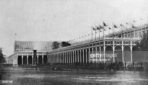 Flags flying on the northwest corner of the Crystal Palace in London's Hyde Park The massive iron and glass structure was designed by Sir Joseph...