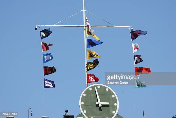 Flags from all 16 National League teams fly above the stadium clock during the game between the Chicago Cubs and the San Francisco Giants at Wrigley...