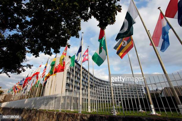 Flags from several countries float in front of the headquarters of the United Nations Educational Scientific and Cultural Organization on October 11...