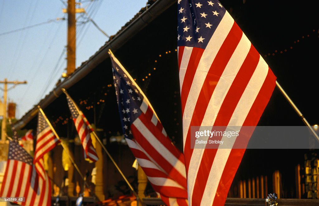 Flags hanging outside diner. : Stock Photo