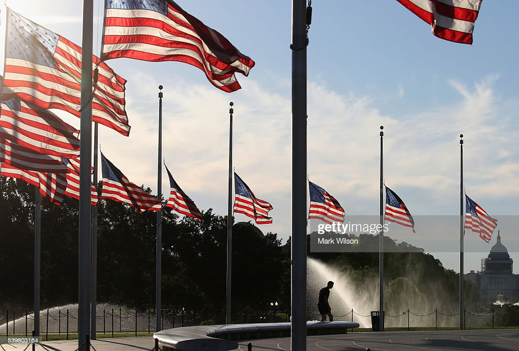 Flags have been lowered to half staff on the Washington Monument grounds to honor those killed by a lone gunman at a night club in Orlando June 2016...