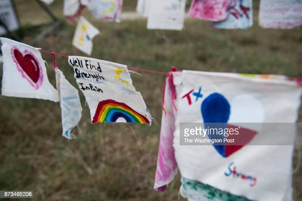 Flags honoring the Sutherland Springs First Baptist Church shooting victims hang near the memorial crosses in Sutherland Springs Texas on November 11...