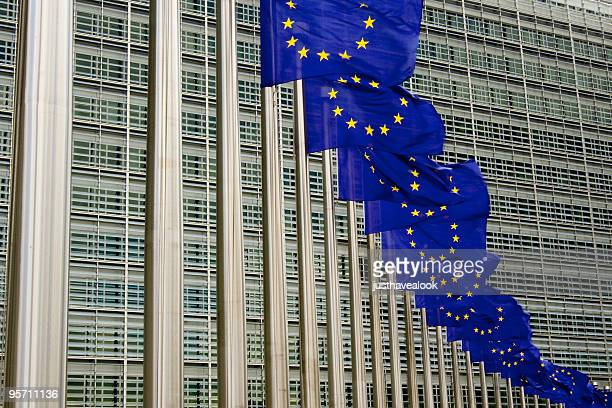 EU flags in Brussels against building