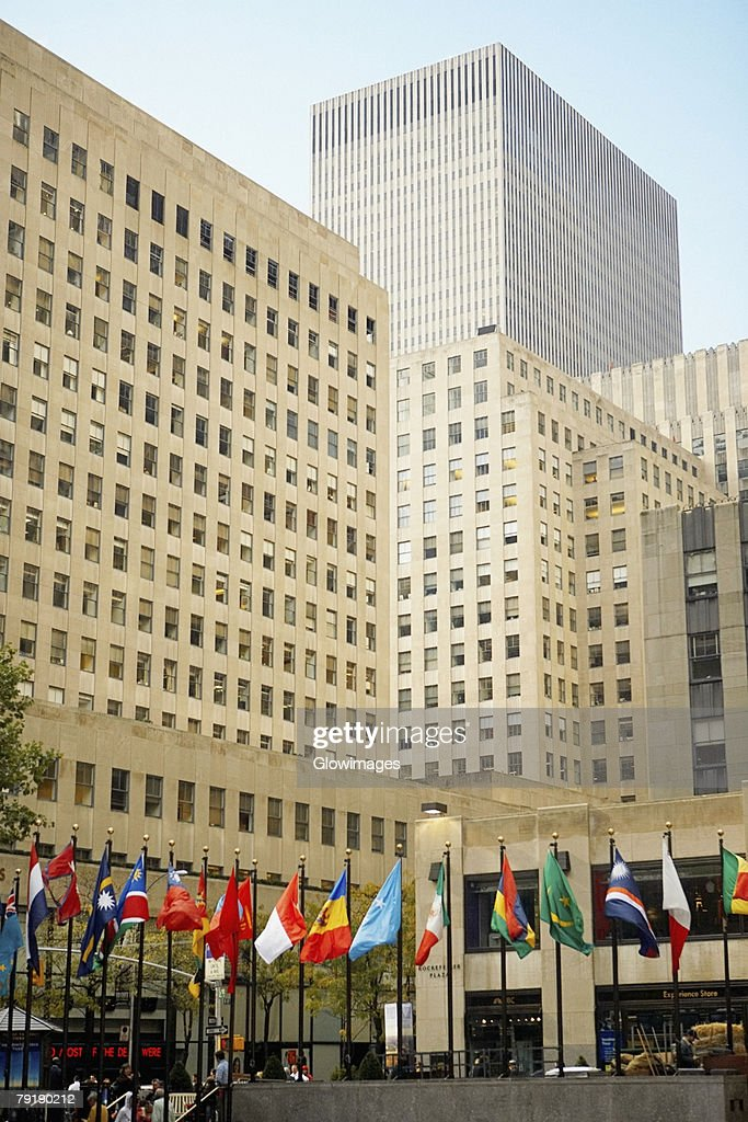 Flags in front of a building, Rockefeller Center, Manhattan, New York City, New York State, USA : Stock Photo