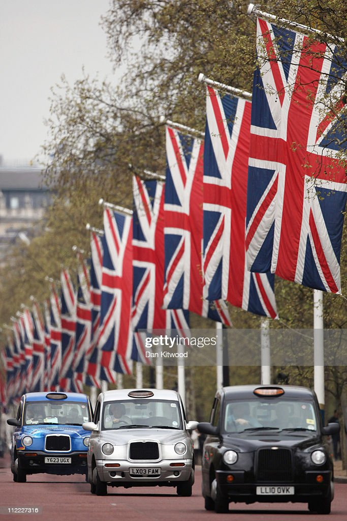 Flags line The Mall leading to Buckingham Palace on April 15, 2011 in London, England. The Mall makes up part of the route that the HRH Prince William and Catherine Middleton will take when they marry two weeks today.