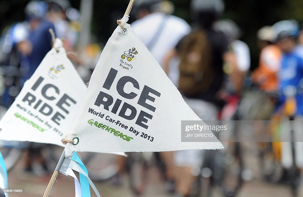 Flags marking an 'Ice Rice' are pictured on the back of bicycles as riders gather to mark 'World Car Free Day' in Manila on September 15, 2013. Environmental activists from Greenpeace and the local group 'Firefly Brigade' took to their bikes to pedal 14 kilometers (9 miles) to join an 'Ice Ride', a global mass bike ride taking place in 110 cities in 36 countries aimed at saving the Arctic. World Car Free Day usually takes place in mid-September and is an annual celebration of cities and public life, free from the noise, stress and pollution of cars aimed at getting people to think about their car use and its impact on the environment, as well as promoting alternatives. AFP PHOTO / Jay DIRECTO