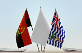 Flags of Angola and BIOT with a white flag in the middle