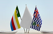 Flags of Comoros and BIOT with a white flag in the middle