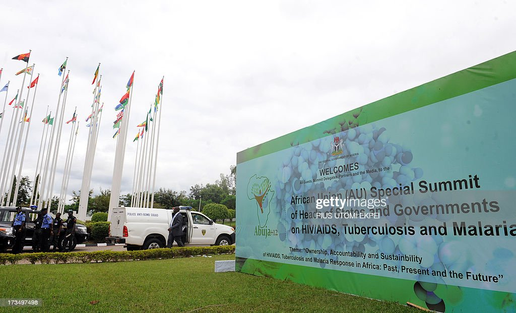Flags of countries fly outside the venue of the African Union Summit on health focusing on HIV/AIDS, tuberculosisi and malaria in Abuja on July 15, 2013. Among the 10 heads of state in attendance was Sudan's President Omar al-Bashir, who is wanted by the International Criminal Court on charges of war crimes, crimes against humanity and genocide.