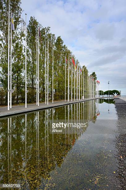 Flags of countries reflected in the lake water