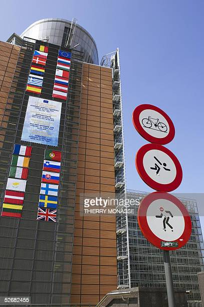 Flags of European Union countries are set on the Berlaymont building the main building of the European Commission 22 April 2005 in Brussels ahead of...