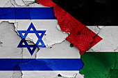flags of Israel and Palestine painted on cracked wall