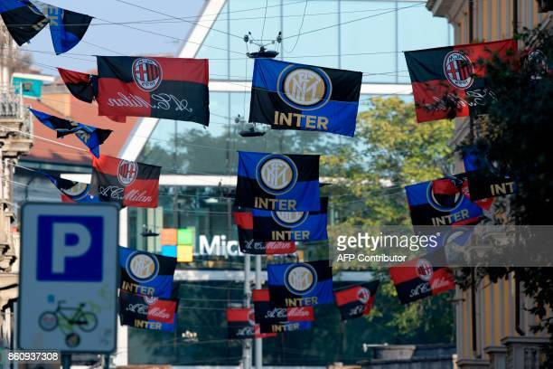 Flags of Italian football clubs Inter Milan and AC Milan are hanged in the Paolo Sarpi street a chinese neighborhood of Milan on October 13 2017...