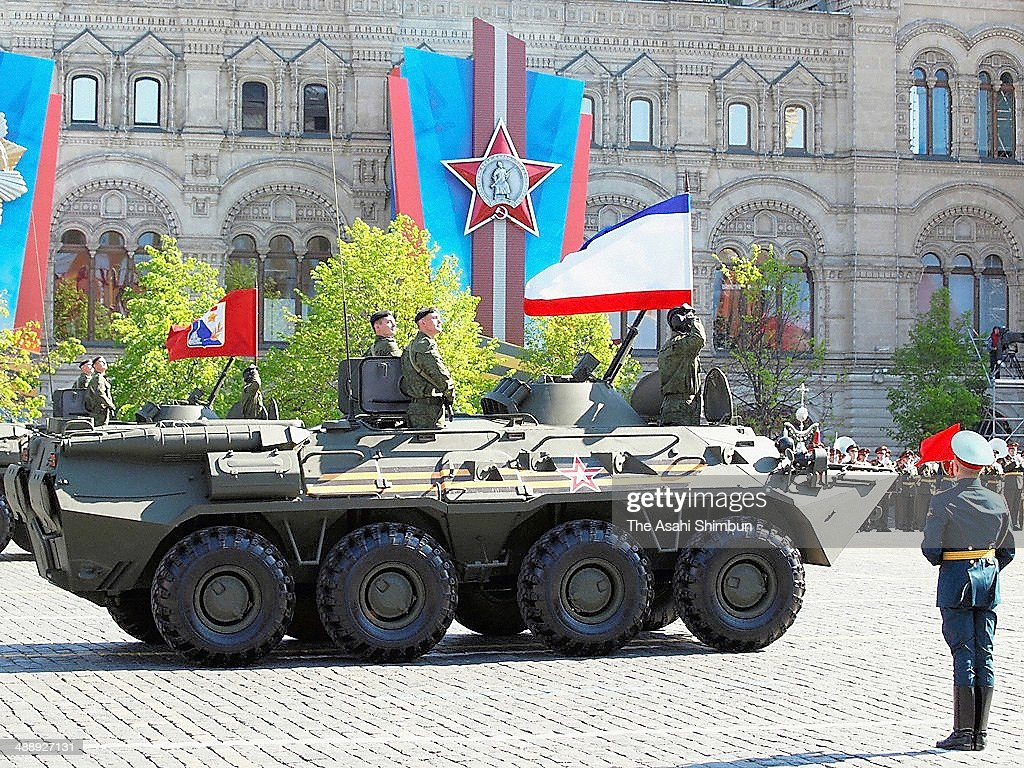 Flags of newly annexed Crimea (front) and 'federal city' of Sevastopol (back) are placed on the tanks during the victory day parade at the Red Square on May 9, 2014 in Moscow, Russia.