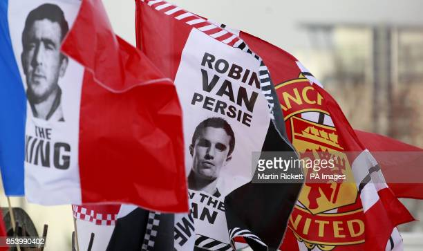 Flags of Robin van Persie and Eric Cantona fly before the Barclays Premier League match at Old Trafford Manchester PRESS ASSOCATION Photo Picture...