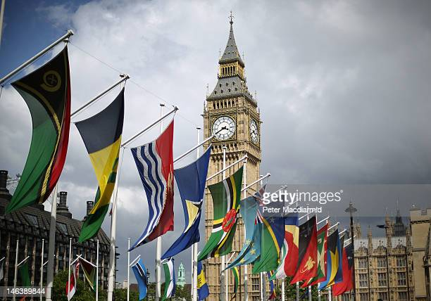 Flags of The Commonwealth Nations are displayed in Parliament Square on June 15 2012 in London England Queen Elizabeth II hosted a lunch for...