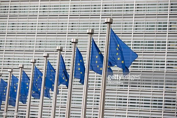 Flags of the European Union fly outside the Berlaymont office building the headquarters of the European Commission in Brussels Belgium on Friday Jan...