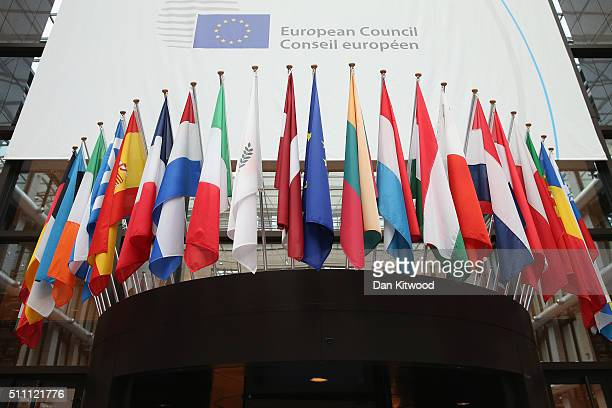 Flags of the European Union member states hang inside the Council of the European Union's Lex building on February 18 2016 in Brussels Belgium Most...