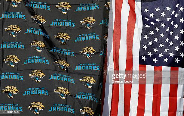 Flags of the Jacksonville Jaguars and United States fly together ahead of the Tennessee Titans versus Jacksonville Jaguars game at EverBank Field on...