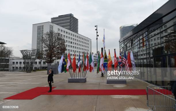 Flags of the participating countries stand in front of the World Conference Center in Bonn western Germany on February 16 the venue of a G20 Foreign...