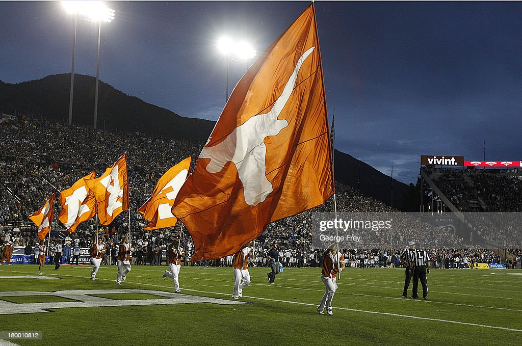 Flags of the Texas Longhorns are run around the field after a touchdown during a game against the BYU Cougars during the first half of an NCAA...