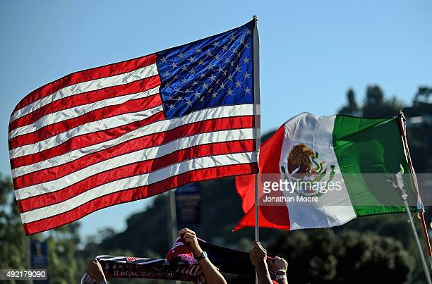 Flags of the United States and Mexico wave before the 2017 FIFA Confederations Cup Qualifier at Rose Bowl on October 10 2015 in Pasadena California