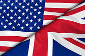 Flags of the USA and the UK Divided Diagonally - 3D Render of the American Flag and British Flag with Silky Texture