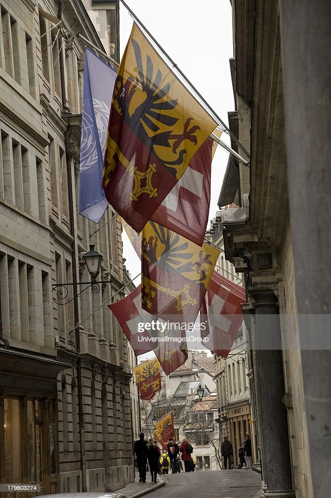 Flags On Street In Old Town Of Geneva, Switzerland.